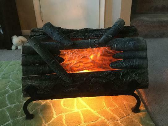 electric real wood logged fireplace crackling logs